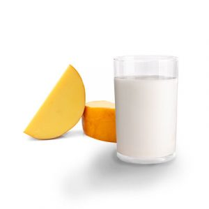 Small wheel of cheese and glass of milk